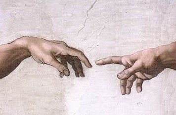 The hands of God and Adam in Michelangelo's famous picture
